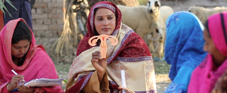 Pathfinder-Pakistan-Lady-Health-Worker-with-uterine-model-in-field-inspire