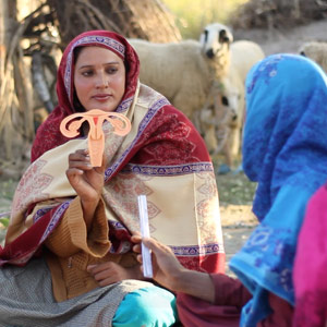 Pathfinder - Pakistan Lady Health Worker with uterine model in field
